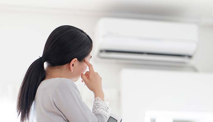 lady looking at air conditioner
